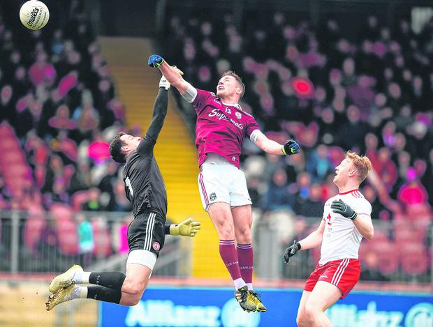 Flying high: Danny Cummins beats Niall Morgan to the ball to score Galway's goal. Photo: David Fitzgerald/Sportsfile