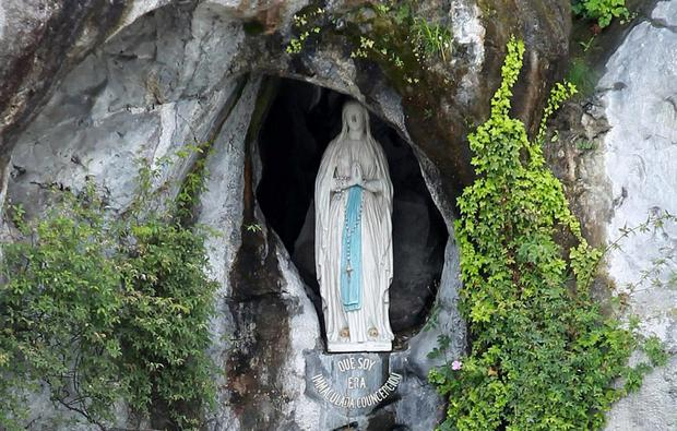 Grotto: Lourdes is visited by six million pilgrims every year. AP Photo