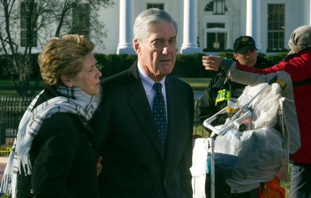 Special Counsel Robert Mueller and his wife Ann, walk past the White House after attending St John's Episcopal Church for morning services yesterday. AP Photo/Cliff Owen