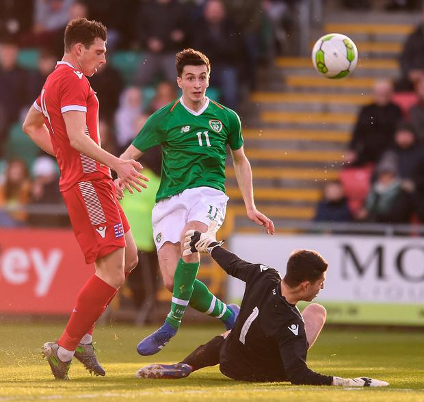 Republic of Ireland's Neil Farrugia shoots to score his side's second goal. Photo: Ben McShane/Sportsfile
