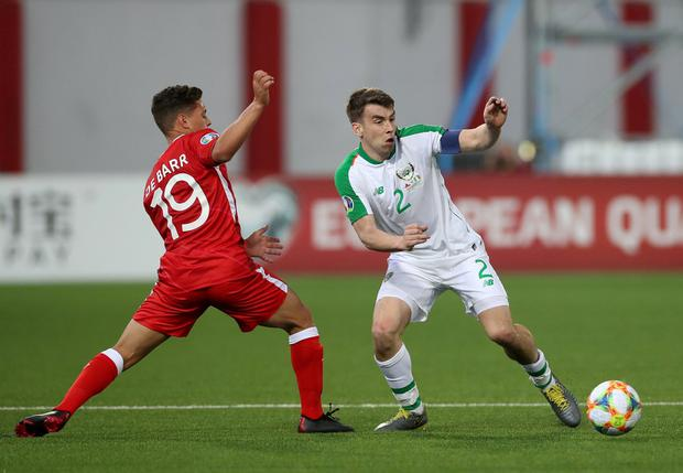 Republic of Ireland's Seamus Coleman in action with Gibraltar's Tjay De Barr. Photo: Peter Cziborra/Action Images via Reuters