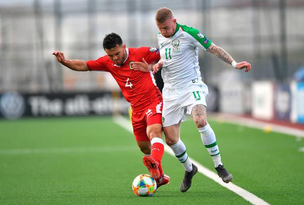 Gibraltar's John Sergeant (left) and Republic of Ireland's James McClean (right) battle for the ball. Photo: Simon Galloway/PA Wire