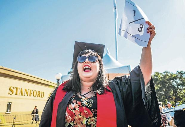Protest: Student Brianne Hunstman encourages Stanford University graduates in California to wear a 1/3 sign on their caps. Statistics claimed one in three students experience a sexual assault by the time they graduate. Photo: Gabrielle Lurie/AFP/Getty