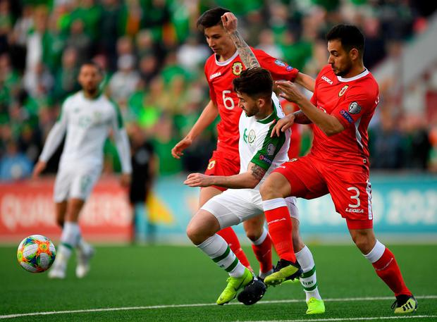 NET HAPPY: Goal-less Ireland striker Seán Maguire tussles with Gibraltar's Louie Annesley (l) and Joseph Chipolina. Photo: Seb Daly/Sportsfile