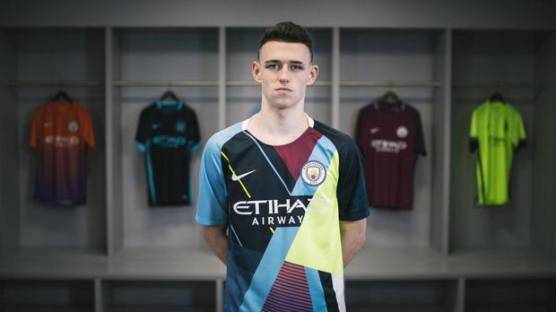 bf091e9a0 Manchester City midfielder Phil Foden models the club s new celebration  shirt. (PA)