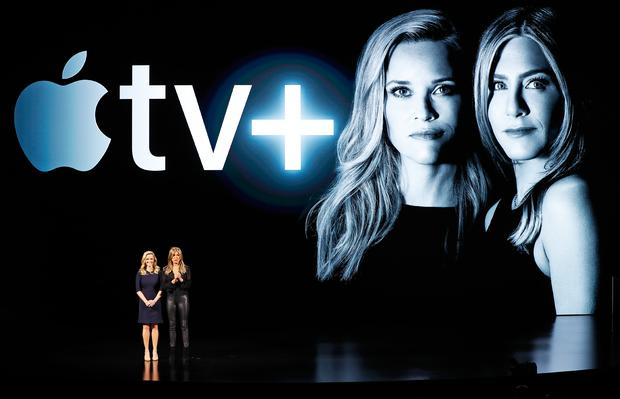 Actors Reese Witherspoon (L) and Jennifer Aniston speak during an Apple special event at the Steve Jobs Theater in Cupertino, California, U.S., March 25, 2019. REUTERS/Stephen Lam