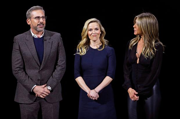 Actors Steve Carrell (L), Reese Witherspoon and Jennifer Aniston (R) speak during an Apple special event at the Steve Jobs Theater in Cupertino, California, U.S., March 25, 2019. REUTERS/Stephen Lam