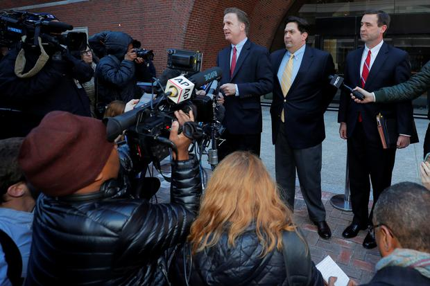 William Ferguson, former women's volleyball coach at Wake Forest University facing charges in a nationwide college admissions cheating scheme, and his lawyers talk to reporters as they arrive at the federal courthouse in Boston, Massachusetts, U.S., March 25, 2019. REUTERS/Brian Snyder