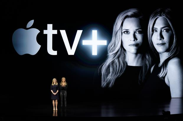 Reese Witherspoon, left, and Jennifer Aniston speak during an event to announce new Apple products (AP)