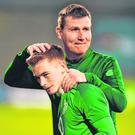 Ireland U-21 manager Stephen Kenny congratulates his man of the match Connor Ronan after Sunday's win over Luxembourg. Photo: Ben McShane/Sportsfile