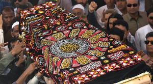Mourning: The coffin of Syed Areeb Ahmed, one of the victims of the mosque attack, is carried high at his funeral in Karachi, Pakistan. Photo: REUTERS/Akhtar Soomro