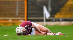 Joe Canning of Galway goes down injured against Waterford. Photo: Sportsfile