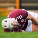 Joe Canning of Galway goes down injured against Waterford