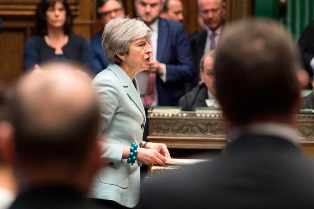 A handout photograph released by the UK Parliament shows Britain's Prime Minister Theresa May making a statement in the House of Commons in London. Photo: MARK DUFFY/AFP/Getty Images