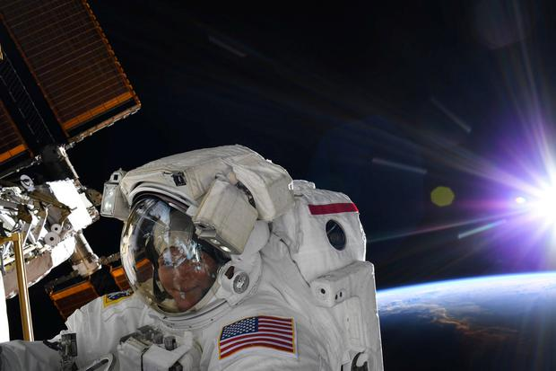 NASA astronaut Anne McClain is seen during a spacewalk at the International Space Station in this social media photo on March 22, 2019. Picture: NASA/Handout via REUTERS