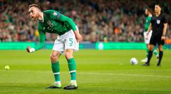 Richard Keogh of Ireland removes a tennis ball thrown onto the pitch in protest at FAI Executive Vice President John Delaney during the 2020 UEFA European Championships group D qualifying match between Republic of Ireland and Georgia at Aviva Stadium on March 26, 2019 in Dublin, Ireland. (Photo by Catherine Ivill/Getty Images)