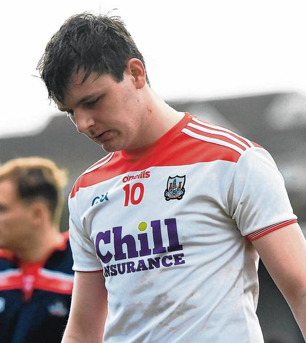 Rebel Hell: Eoghan McSweeney leaves the field after Cork's victory over Armagh which still saw them relegated to Division 3. Photo: Ramsey Cardy/Sportsfile