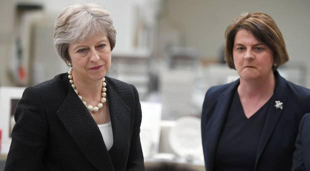 British Prime Minister Theresa May (left) and DUP leader Arlene Foster. Photo: Clodagh Kilcoyne/AP