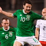 Ireland's Robbie Brady in mid-air as Georgia's Nika Kvekveskiri slides in. Photo: Sportsfile