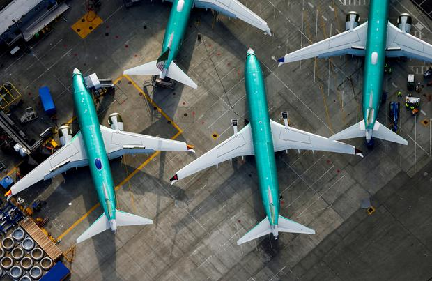 An aerial photo shows Boeing 737 MAX airplanes parked on tarmac REUTERS/Lindsey Wasson/File Photo