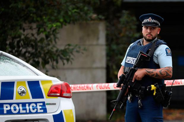 Security: A police officer stands guard after the massacre in Christchurch, New Zealand. Photo: AFP