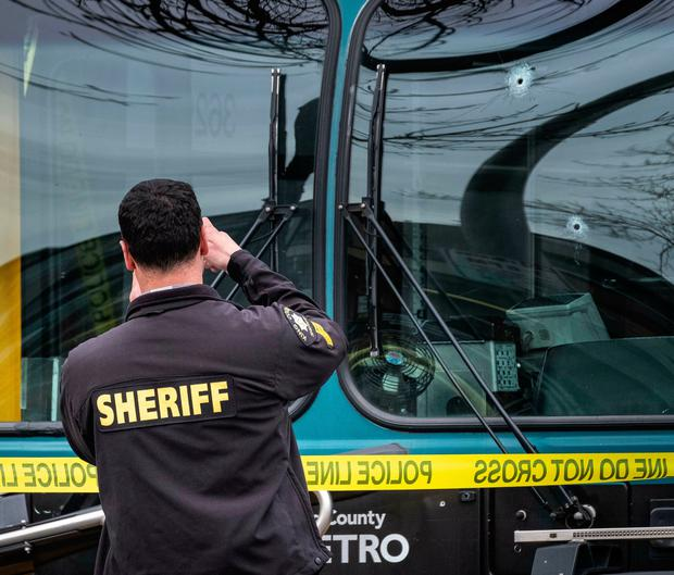 Several bullet holes can be seen in the driver's side window of a Metro Bus on Northeast 125th Street, between 32nd and 33rd Avenues Northeast after a shooting in Seattle, Wednesday March 27, 2019