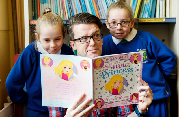 Tony Cummins, an ESB volunteer on Business in the Community Ireland's 'Time to Read' literacy volunteering programme partnered with Amber and Rhianna Skerritt from St. Mary's school in Fairview, Dublin