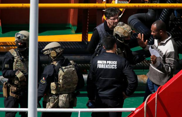 Maltese special forces soldiers talk with members of the crew of the merchant ship Elhiblu 1 after it arrived in Senglea, in Valletta's Grand Harbour, Malta, March 28, 2019. REUTERS/Darrin Zammit Lupi