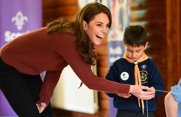 Britain's Catherine, Duchess of Cambridge reacts during her visit to the Scouts' headquarters at Gilwell Park, north London on March 29, 2019