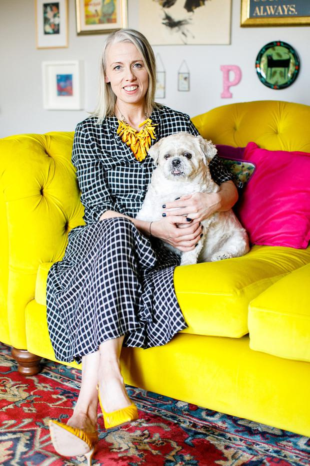Joanne Mooney with her dog are mellow on yellow