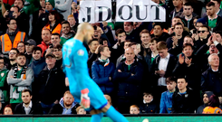 Darren Randolph kicks tennis balls off the pitch following a protest by some fans against John Delaney. Photo: PA