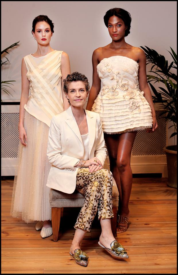 Fashion Designer Helen Cody with models Eabha O'Donoghue and Hillary Mohr (right) wearing some of her creations at the ARC Designer Fashion Show at the RDS last night. Picture: Steve Humphreys