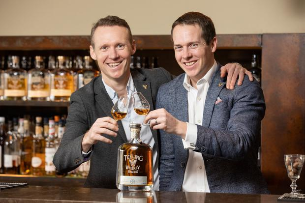 Liquid gold: Jack and Stephen Teeling raise a glass to their 24-year-old single malt, voted the best in the world. Photo: Naoise Culhane Photography
