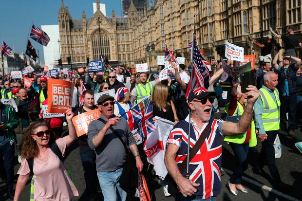 Pro-Brexit demonstrators march past the Houses of Parliament. Photo: AFP/Getty Images