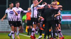 Dundalk players and coaching staff celebrate their side's first goal