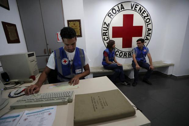 Employees work at the Venezuelan Red Cross in Caracas, Venezuela yesterday. Photo: Ivan Alvarado/Reuters
