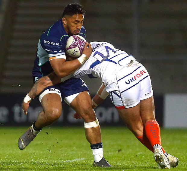 Connacht's Bundee Aki is tackled by Denny Solomona of Sale. Photo: Philip Oldham/Sportsfile