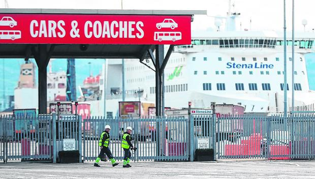 Preparations: Workers walking past the check-in facilities at Dublin Port. Photo: Niall Carson/PA