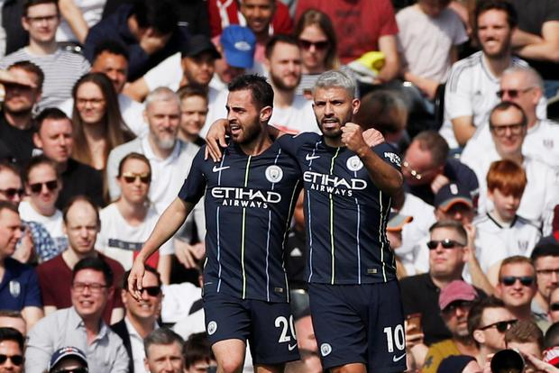 Manchester City's Sergio Aguero celebrates scoring their second goal with Bernardo Silva