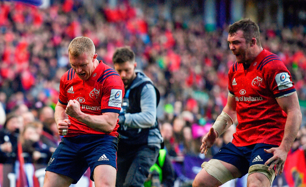 Keith Earls of Munster celebrates with team-mate Peter O'Mahony