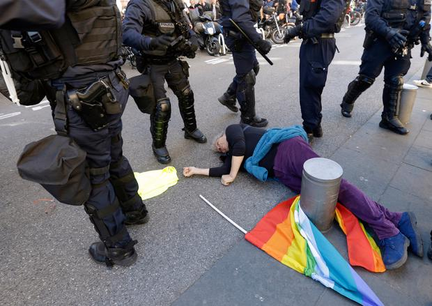 Anti-globalization activist Genevieve Legay, 73, lies unconscious after collapsing on the ground during a protest in Nice (AP Photo/Claude Paris, File)