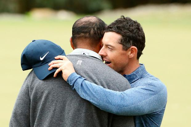 Tiger Woods embraces Rory McIlroy