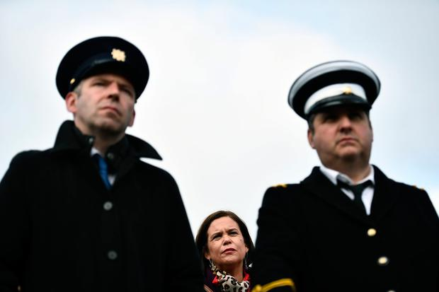 Sinn Fein President Mary Lou McDonald watches on between two mock customs officers as the Border Communities Against Brexit group hold a protest along the border (Photo by Charles McQuillan/Getty Images)