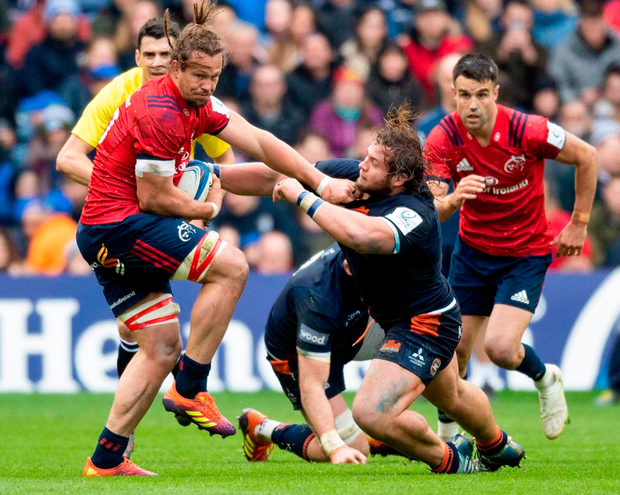 Munster's Arno Botha fends off Pierre Schoeman of Edinburgh during yesterday's bruising match at Murrayfield. Photo: Paul Devlin/Sportsfile