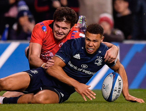 Leinster's Adam Byrne his side's second try despite the attention of Jacob Stockdale of Ulster. Photo: Stephen McCarthy/Sportsfile