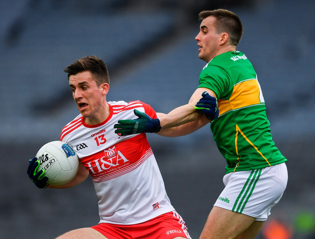Derry's Shane McGuigan is put under pressure by Paddy Maguire yesterday. Photo: Ray McManus/Sportsfile