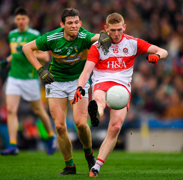 Derry's Christopher Bradley in action against Aidan Flynn of Leitrim. Photo: Ray McManus/Sportsfile