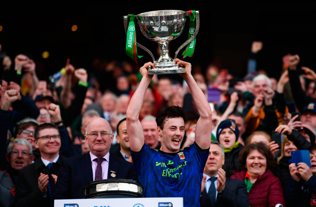 Diarmuid O'Connor of Mayo lifts the cup