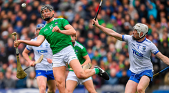 Gearoid Hegarty fires the sliotar one-handed over the bar despite the efforts of Waterford's Tadhg De Búrca; inset below, Declan Hannon lifts the trophy. Photo by Ray McManus/Sportsfile