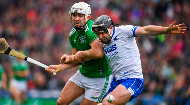 Limerick's Aaron Gillane and Noel Connors of Waterford are locked in a battle for possession during yesterday's game. Photo by Ray McManus/Sportsfile